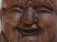 smiling buddha wood carving